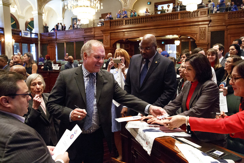 Illinois lawmakers line up to get an autograph from Chicago Cubs Hall of Fame second baseman Ryne Sandberg after the World Champion Cubs were honored during a joint session of the Illinois General Assembly Wednesday, March 8, 2017 at the Capitol in Springfield, Ill. [Rich Saal/The State Journal-Register]