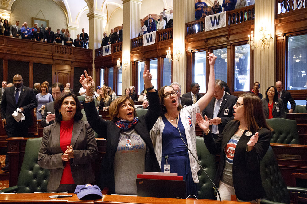 "Illinois Representatives Lisa Hernandez, D-Cicero, left; Sara Feigenholtz, D-Chicago; Kelly Cassidy, D-Chicago and Ann Williams, D-Chicago lead a joint session of the Illinois General Assembly in singing ""Go Cubs Go"" when the World Champion Chicago Cubs were honored at the Capitol in Springfield, Ill. Wednesday, March 8, 2017. [Rich Saal/The State Journal-Register]"
