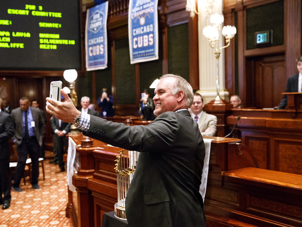 Chicago Cubs Hall of Fame second baseman Ryne Sandberg snaps a selfie with the World Champion Cubs' trophy in the Illinois House Wednesday, March 8, 2017. The Cubs were honored during a joint session of the Illinois General Assembly. [Rich Saal/The State Journal-Register]