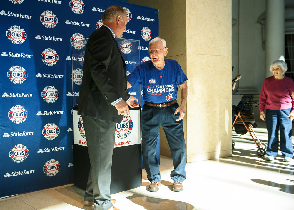 "Ray Bulinski, 89, meets Chicago Cubs Hall of Fame second baseman Ryne Sandberg to get his picture taken with the Chicago Cubs World Series trophy at the Abraham Lincoln Presidential Museum, Wednesday, March 8, 2017, in Springfield, Ill. ""It was beautiful, it's a little emotional because of my relationship to the sport,"" said Bulinski, a former umpire that went to to his first Cubs game when he was six years old. [Justin L. Fowler/The State Journal-Register"