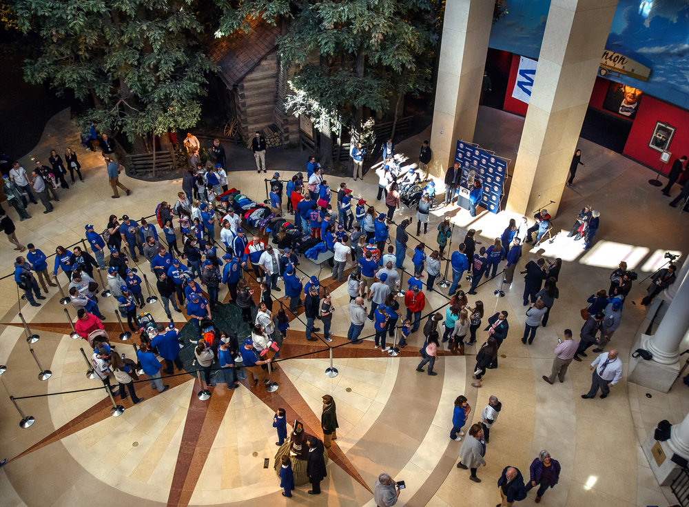 Over 900 fans has the opportunity to get their picture taken with the Chicago Cubs World Series trophy at the Abraham Lincoln Presidential Museum, Wednesday, March 8, 2017, in Springfield, Ill. [Justin L. Fowler/The State Journal-Register