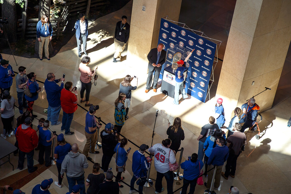 Fans line up to have their picture taken with the Chicago Cubs World Series trophy and Chicago Cubs Hall of Fame second baseman Ryne Sandberg at the Abraham Lincoln Presidential Museum, Wednesday, March 8, 2017, in Springfield, Ill. [Justin L. Fowler/The State Journal-Register
