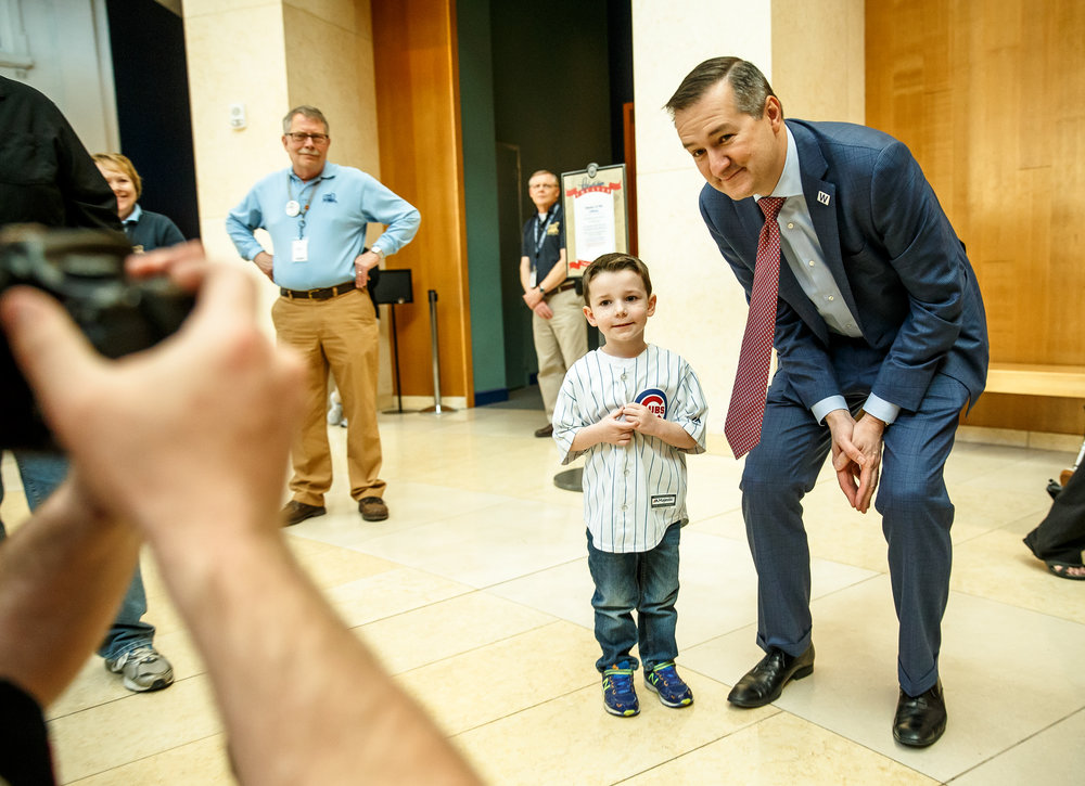 Easton Caraway, 4, of Altamont, Ill., poses with Chicago Cubs Chairman Tom Ricketts as fans get their chance to be photographed with the Chicago Cubs World Series trophy at the Abraham Lincoln Presidential Museum, Wednesday, March 8, 2017, in Springfield, Ill. [Justin L. Fowler/The State Journal-Register
