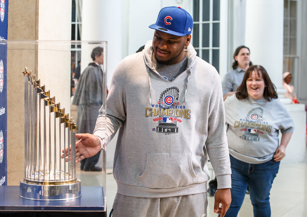 "Michael Jones pauses to take in the Chicago Cubs' World Series trophy after getting his photo taken with it while on display at the Abraham Lincoln Presidential Museum, Wednesday, March 8, 2017, in Springfield, Ill. ""It's breathtaking...I couldn't believe that it's here,"" said Jones. ""I couldn't believe I just took a picture with the owner. This is amazing, it's a great feeling."" [Justin L. Fowler/The State Journal-Register"