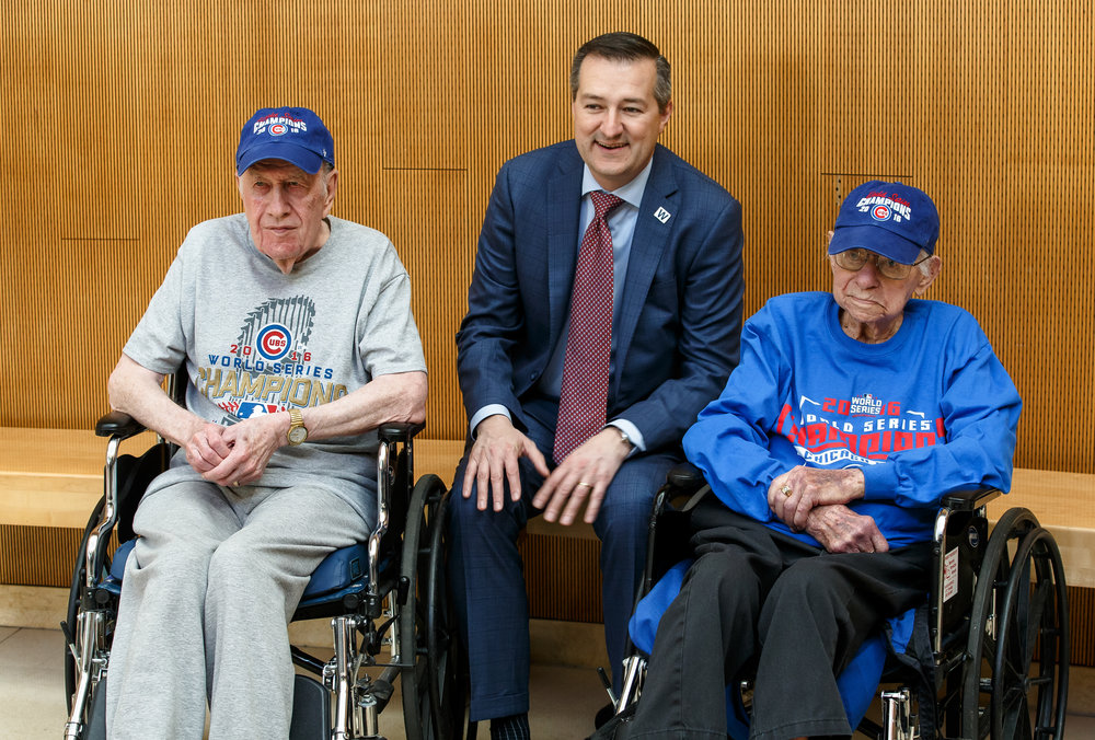 Chicago Cubs' chairman Tom Ricketts visits with long time Chicago Cubs fans Jerry Mosselman, 86, and Alvin Hysler, 100, as they watch fans gather to have their picture taken with the Chicago Cubs World Series trophy at the Abraham Lincoln Presidential Museum, Wednesday, March 8, 2017, in Springfield, Ill. [Justin L. Fowler/The State Journal-Register