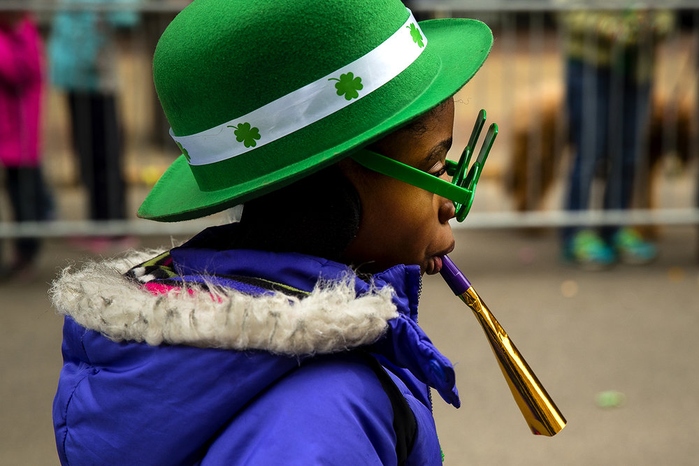 Takiyah McCrary marches with an entry from St. Patrick's School during the St. Patrick's Day Parade Saturday, March 11, 2017. [Ted Schurter/The State Journal-Register]