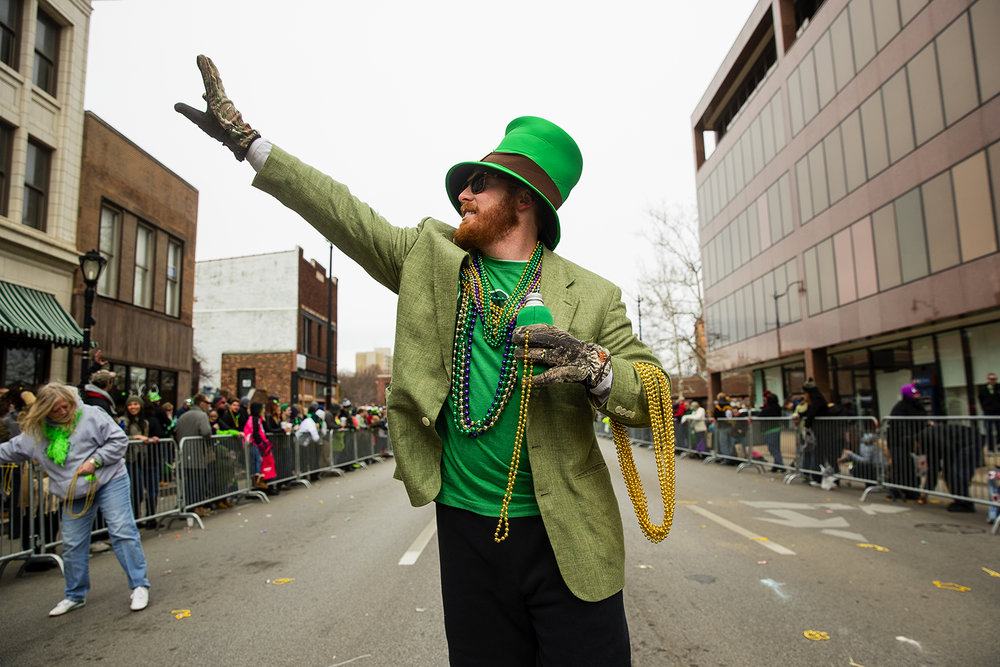 Trevor Parnell marches with the Ryan family during the St. Patrick's Day Parade Saturday, March 11, 2017. [Ted Schurter/The State Journal-Register]