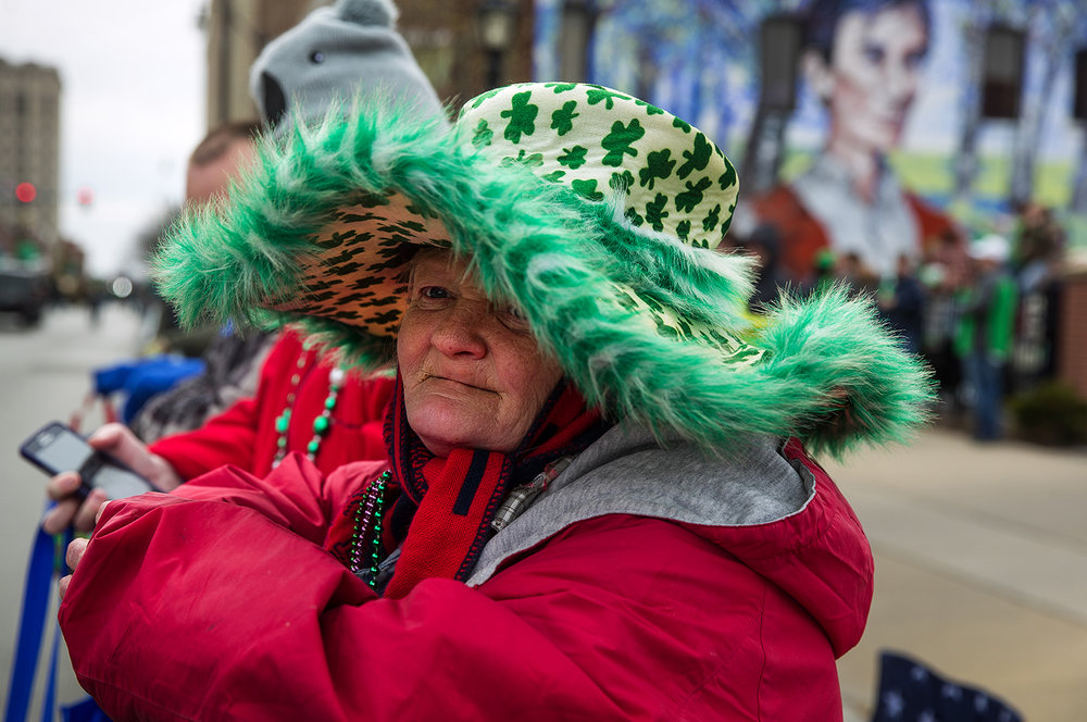 Peggy Duffey watches the St. Patrick's Day Parade from underneath her wide-brimmed floppy holiday hat Saturday, March 11, 2017. [Ted Schurter/The State Journal-Register]