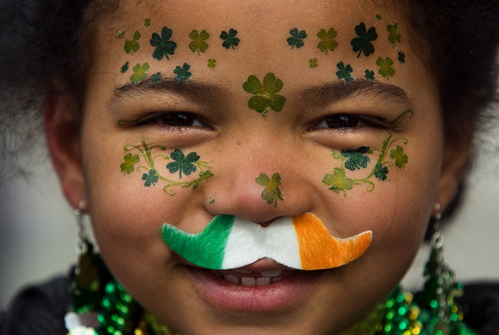 Seven-year-old Destiny Holman added the shamrock decorations to her face all by herself just for the St. Patrick's Day Parade Saturday, March 11, 2017. [Ted Schurter/The State Journal-Register]