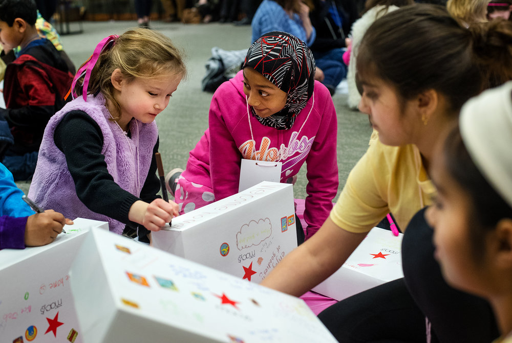 Macklin Metzger, left, and Mahdia Uddin decorate a care package box together during a Children of Abraham event at the Abraham Lincoln Presidential Library Sunday, March 5, 2017. The children from the congregations of Grace Methodist Church, Islamic Society of Greater Springfield, Temple Israel Synagogue, and Westminster Presbyterian Church visited the respective houses of worship to learn about different faith traditions. [Ted Schurter/The State Journal-Register]