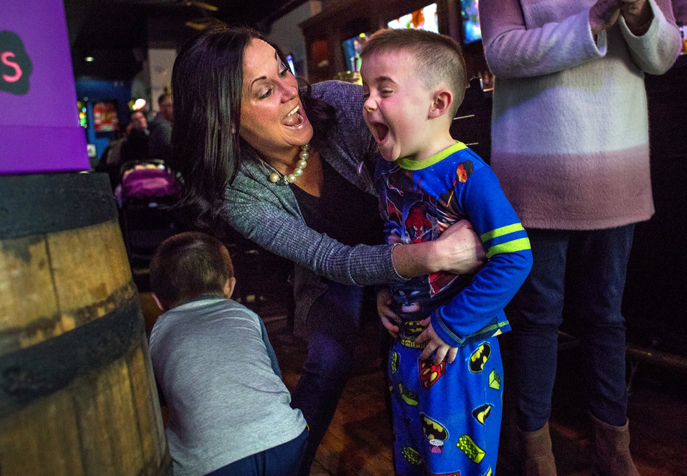 Cash Wilkin lets out a celebratory yell as he hugs his mom Mila after winning the pajama contest during the Pajama Brunch and Toy Drive at Balen's Bar and Grill Sunday, March 5, 2017. The event was organized by seven-year-old Lexi Sonneborn and her family. Lexi was born premature and spent her first three months in St. John's Neonatal Intensive Care Unit, and her next three Christmases in their Pediatric Care Unit. She enjoys delivering toys to patients and all the toys and donations from Sunday's event will be donated to HSHS St. John's Children's Hospital. [Ted Schurter/The State Journal-Register]