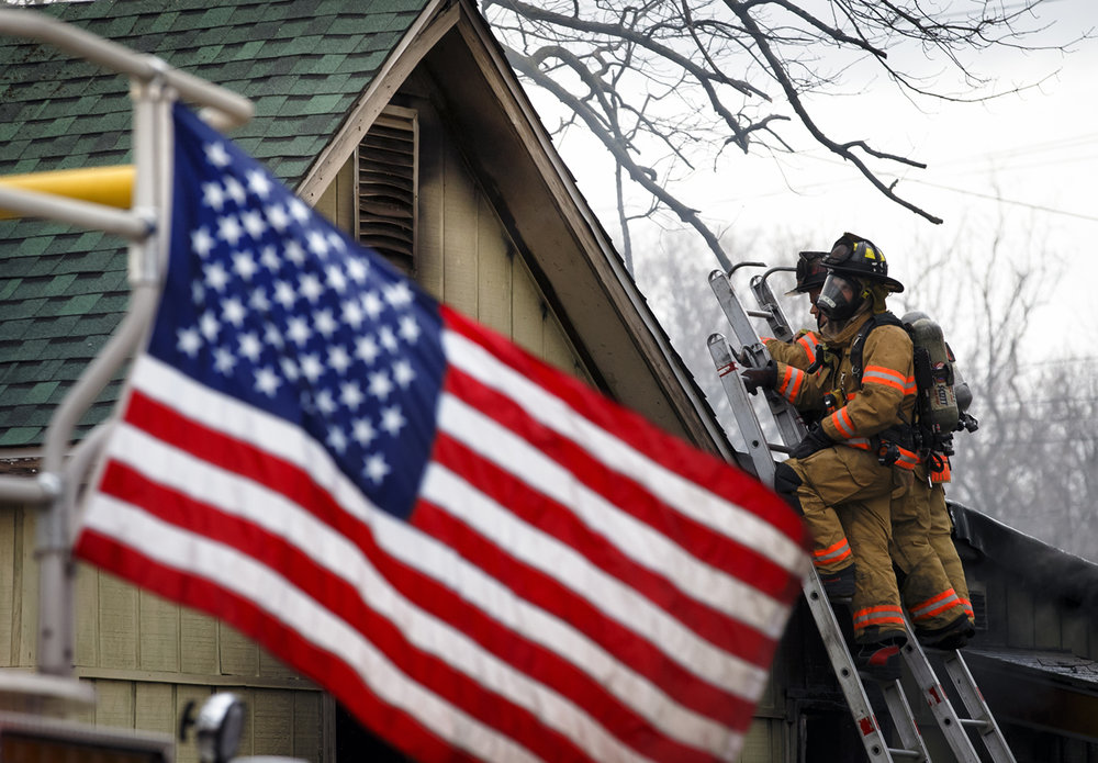 Firefighters from the Springfield Fire Dept. extinguish hot spots from a blaze inside a home on the 400 block of East Iles Avenue in Springfield, Ill., Monday, March 6, 2017. Justin L. Fowler/The State Journal-Register