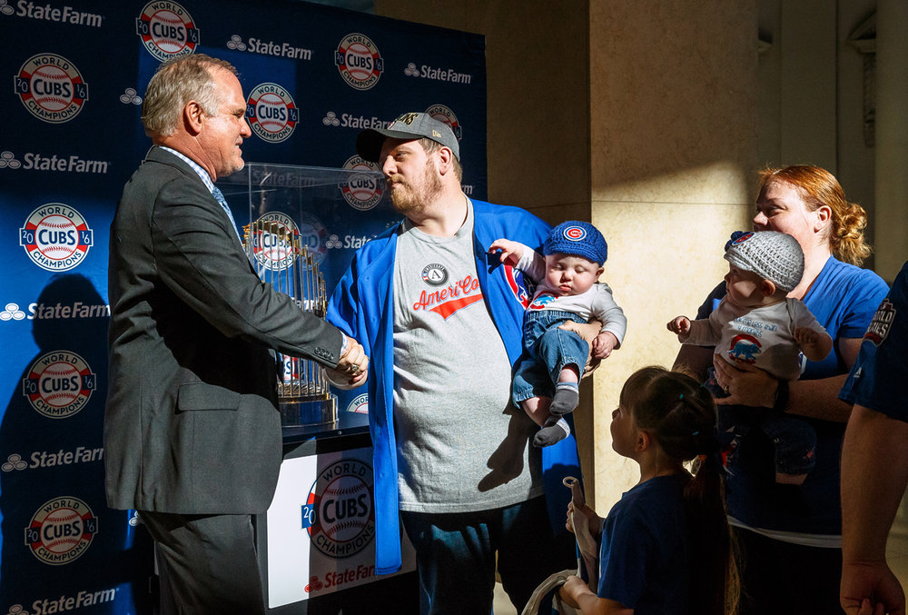 Scott and Amber McFarland, along with their twins Clark and Addison, named after the streets in front of Wrigley Field, and their daughter Anastasia, meet Chicago Cubs Hall of Fame second baseman Ryne Sandberg after getting their picture taken with the Chicago Cubs World Series trophy at the Abraham Lincoln Presidential Museum, Wednesday, March 8, 2017, in Springfield, Ill. [Justin L. Fowler/The State Journal-Register