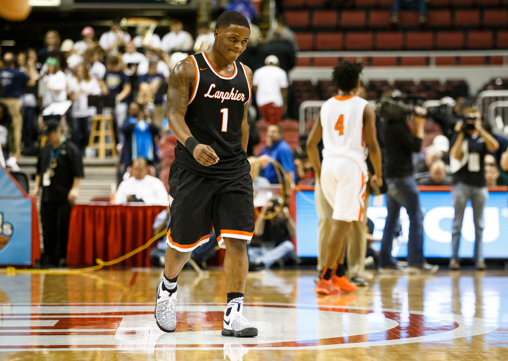 Lanphier's Yaakema Rose (1) walks off the court after Chicago Morgan Park defeated the Lions 60-53 in the semifinals of the IHSA Class 3A Basketball State Finals at Carver Arena, Friday, March 17, 2017, in Peoria, Ill. [Justin L. Fowler/The State Journal-Register]
