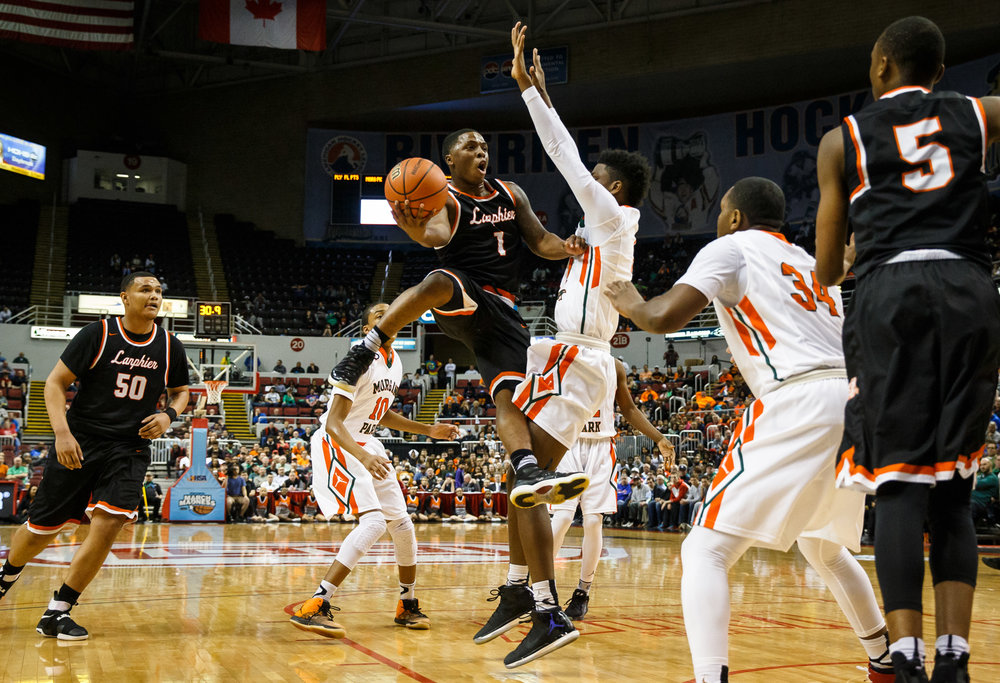 Lanphier's Yaakema Rose (1) collides with Chicago Morgan Park's Tamell Pearson (1) as he tries to drive into the basket in the first quarter during the semifinals of the IHSA Class 3A Basketball State Finals at Carver Arena, Friday, March 17, 2017, in Peoria, Ill. [Justin L. Fowler/The State Journal-Register]