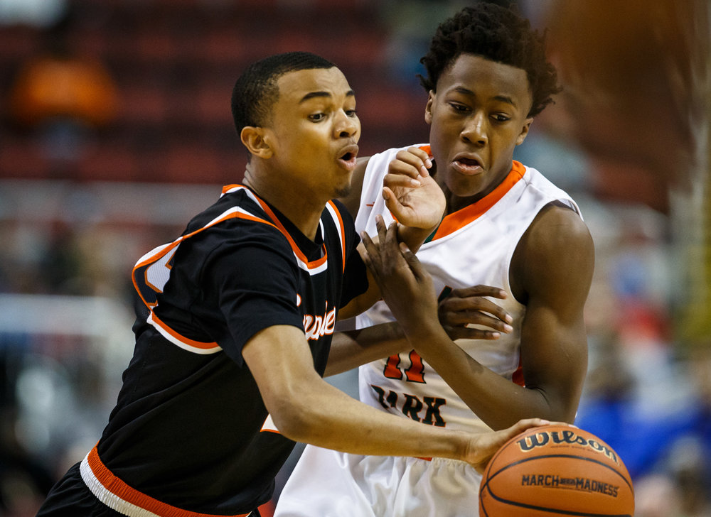 Lanphier's Cardell McGee (2) collides with Chicago Morgan Park's Ayo Dosunmu (11) as he drives down the court in the first quarter during the semifinals of the IHSA Class 3A Basketball State Finals at Carver Arena, Friday, March 17, 2017, in Peoria, Ill. [Justin L. Fowler/The State Journal-Register]