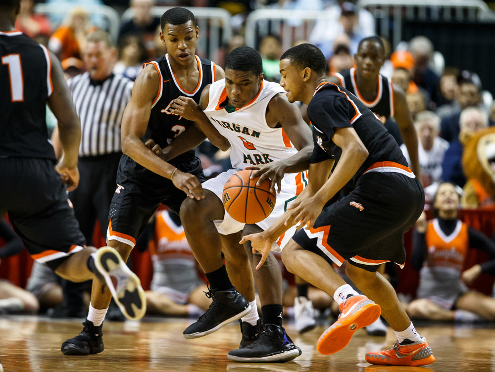 Lanphier's Cardell McGee (2) steals the ball away from Chicago Morgan Park's Lamond Johnson (0) as he gets tangled up with Lanphier's Aundrae Williams (3) in the first quarter during the semifinals of the IHSA Class 3A Basketball State Finals at Carver Arena, Friday, March 17, 2017, in Peoria, Ill. [Justin L. Fowler/The State Journal-Register]