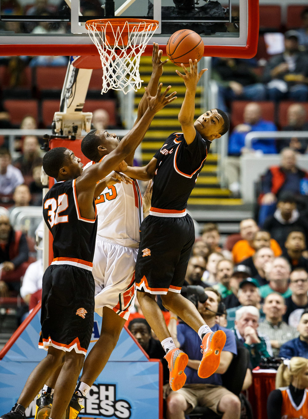 Lanphier's Cardell McGee (2) goes for a rebound against Chicago Morgan Park's Lenell Henry (23) in the first quarter during the semifinals of the IHSA Class 3A Basketball State Finals at Carver Arena, Friday, March 17, 2017, in Peoria, Ill. [Justin L. Fowler/The State Journal-Register]