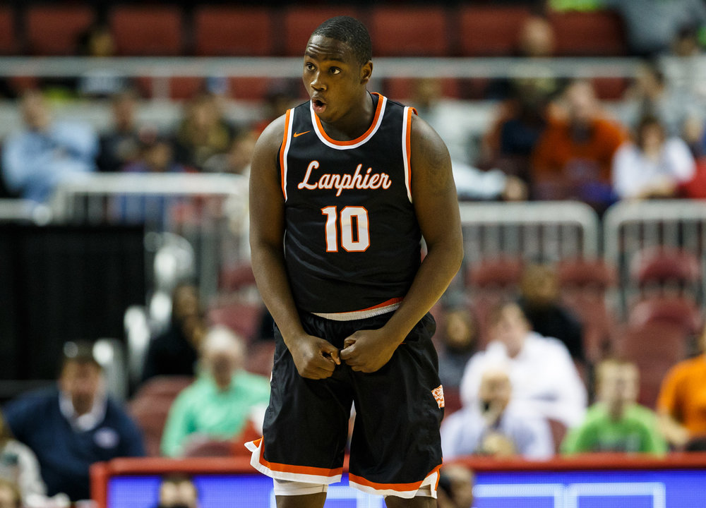 Lanphier's Corrington Jones (10) reacts after hitting a 3-pointer against Chicago Morgan Park in the first quarter during the semifinals of the IHSA Class 3A Basketball State Finals at Carver Arena, Friday, March 17, 2017, in Peoria, Ill. [Justin L. Fowler/The State Journal-Register]