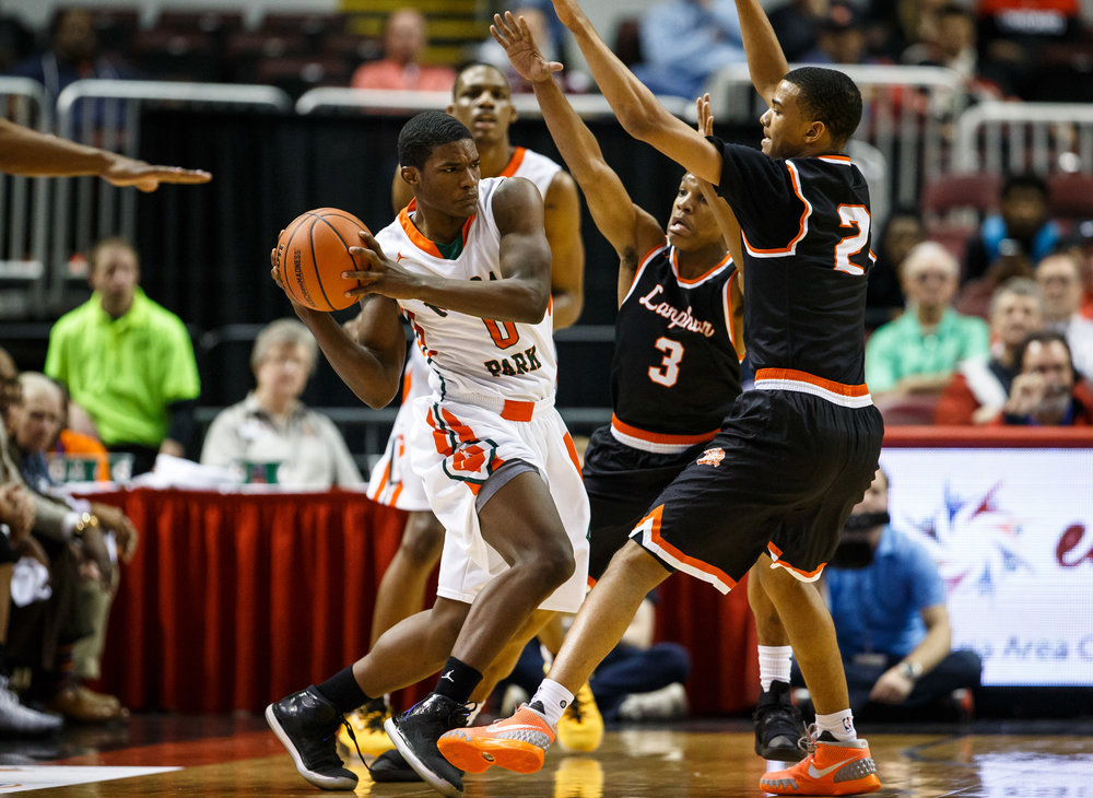 Chicago Morgan Park's Lamond Johnson (0) is pressured by Lanphier's Aundrae Williams (3) and Lanphier's Cardell McGee (2) in the first quarter during the semifinals of the IHSA Class 3A Basketball State Finals at Carver Arena, Friday, March 17, 2017, in Peoria, Ill. [Justin L. Fowler/The State Journal-Register]
