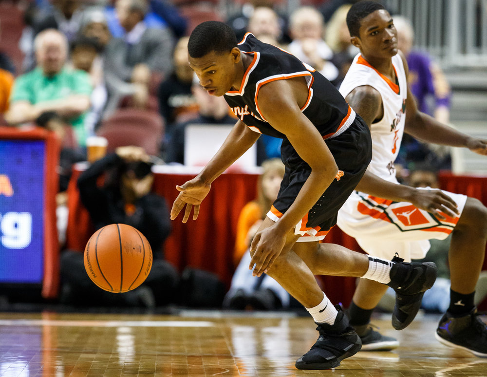 Lanphier's Aundrae Williams (3) grabs a steal from Chicago Morgan Park's Lamond Johnson (0) in the first quarter during the semifinals of the IHSA Class 3A Basketball State Finals at Carver Arena, Friday, March 17, 2017, in Peoria, Ill. [Justin L. Fowler/The State Journal-Register]