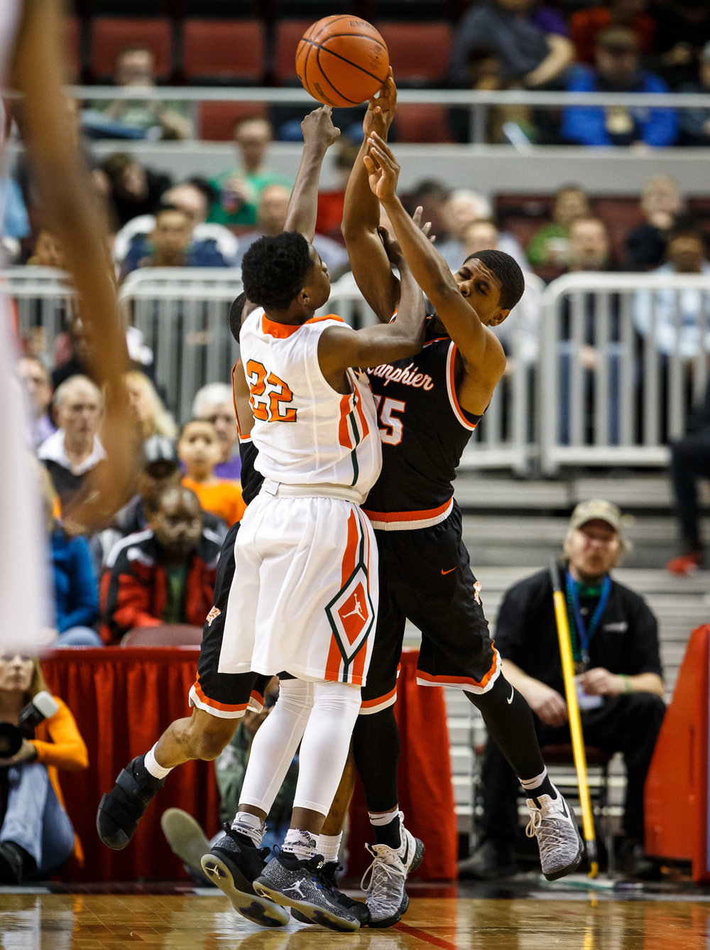 Lanphier's Stanley Morgan (15) collides with Chicago Morgan Park's Marcus Watson (22) going for a rebound in the second quarter during the semifinals of the IHSA Class 3A Basketball State Finals at Carver Arena, Friday, March 17, 2017, in Peoria, Ill. [Justin L. Fowler/The State Journal-Register]