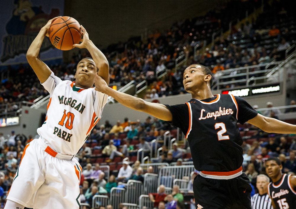 Lanphier's Cardell McGee (2) fouls Chicago Morgan Park's Nimari Burnett (10) as he goes for a rebound in the second quarter during the semifinals of the IHSA Class 3A Basketball State Finals at Carver Arena, Friday, March 17, 2017, in Peoria, Ill. [Justin L. Fowler/The State Journal-Register]