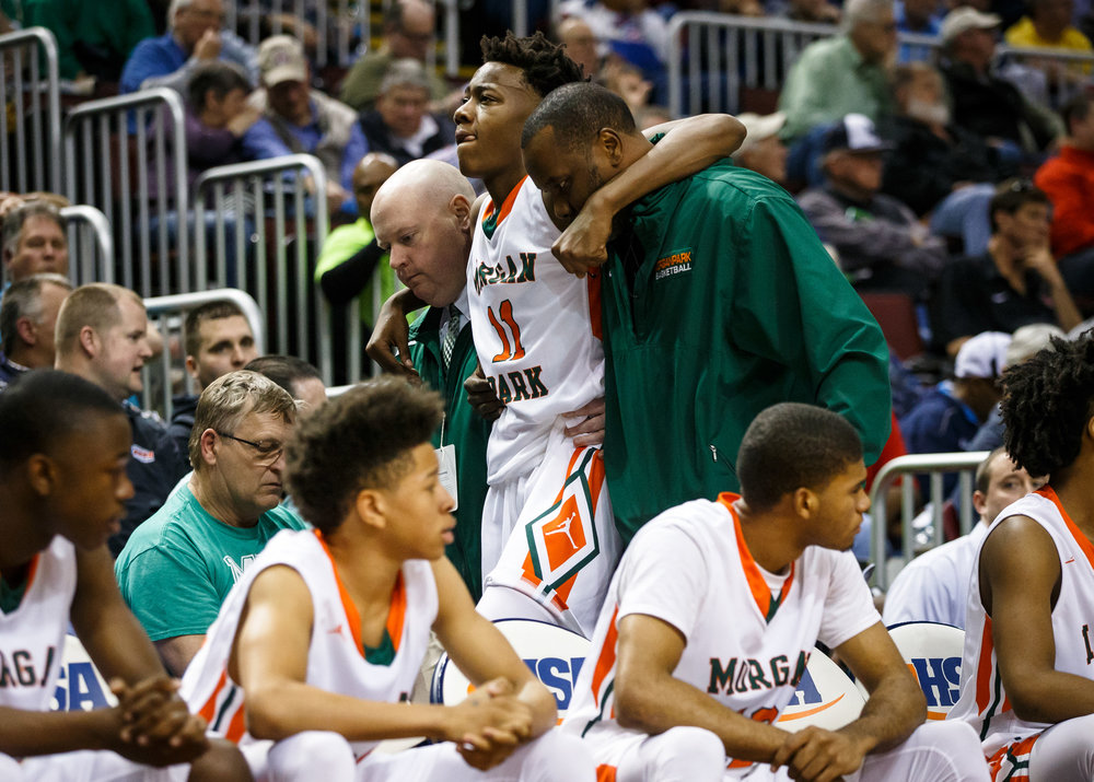 Chicago Morgan Park's Ayo Dosunmu (11) is helped back to the bench after being injured as the Mustangs take on Lanphier in the second quarter during the semifinals of the IHSA Class 3A Basketball State Finals at Carver Arena, Friday, March 17, 2017, in Peoria, Ill. [Justin L. Fowler/The State Journal-Register]