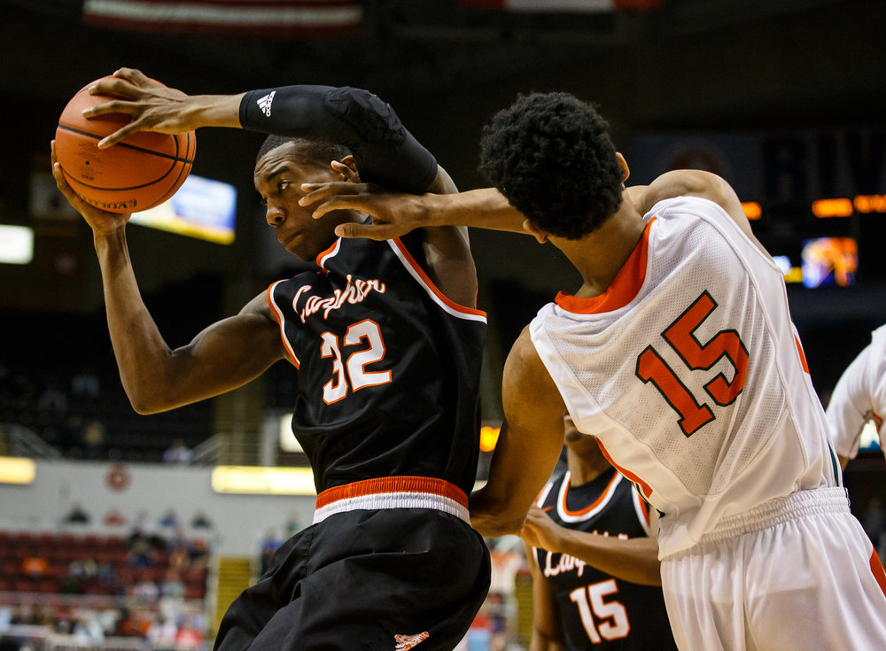 Lanphier's Karl Wright III (32) pulls in a rebound against Chicago Morgan Park's Melo Burrell (15) in the second quarter during the semifinals of the IHSA Class 3A Basketball State Finals at Carver Arena, Friday, March 17, 2017, in Peoria, Ill. [Justin L. Fowler/The State Journal-Register]