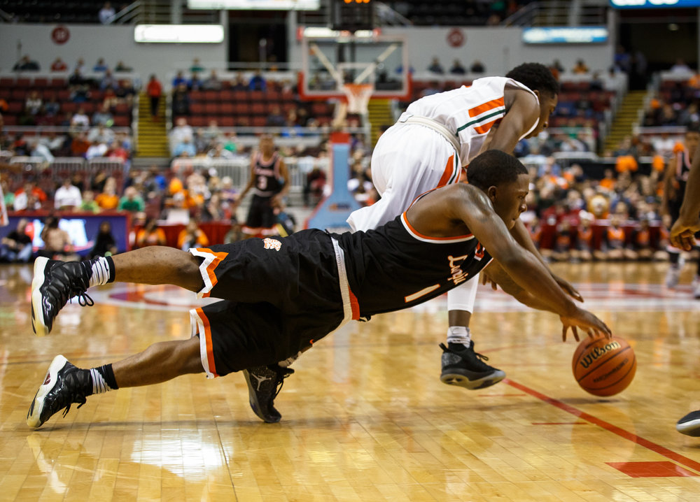 Lanphier's Yaakema Rose (1) dives out trying to force a turnover from Chicago Morgan Park's Marcus Watson (22) in the second quarter during the semifinals of the IHSA Class 3A Basketball State Finals at Carver Arena, Friday, March 17, 2017, in Peoria, Ill. [Justin L. Fowler/The State Journal-Register]