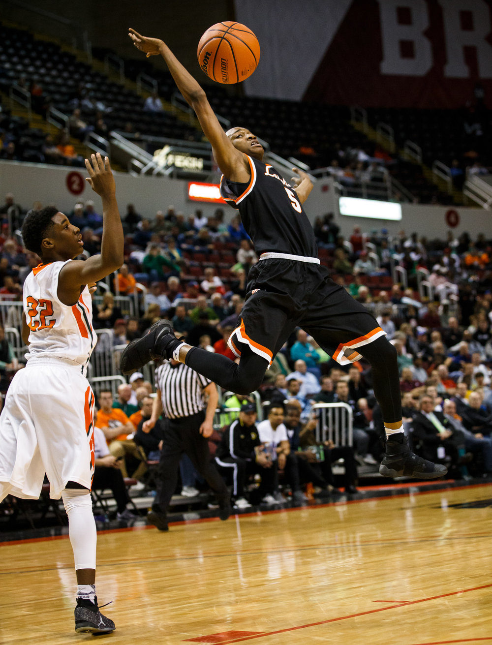 Lanphier's James Jones (5) loses control of the ball as he is hit by Chicago Morgan Park's Marcus Watson (22) driving up to the basket in the third quarter during the semifinals of the IHSA Class 3A Basketball State Finals at Carver Arena, Friday, March 17, 2017, in Peoria, Ill. [Justin L. Fowler/The State Journal-Register]