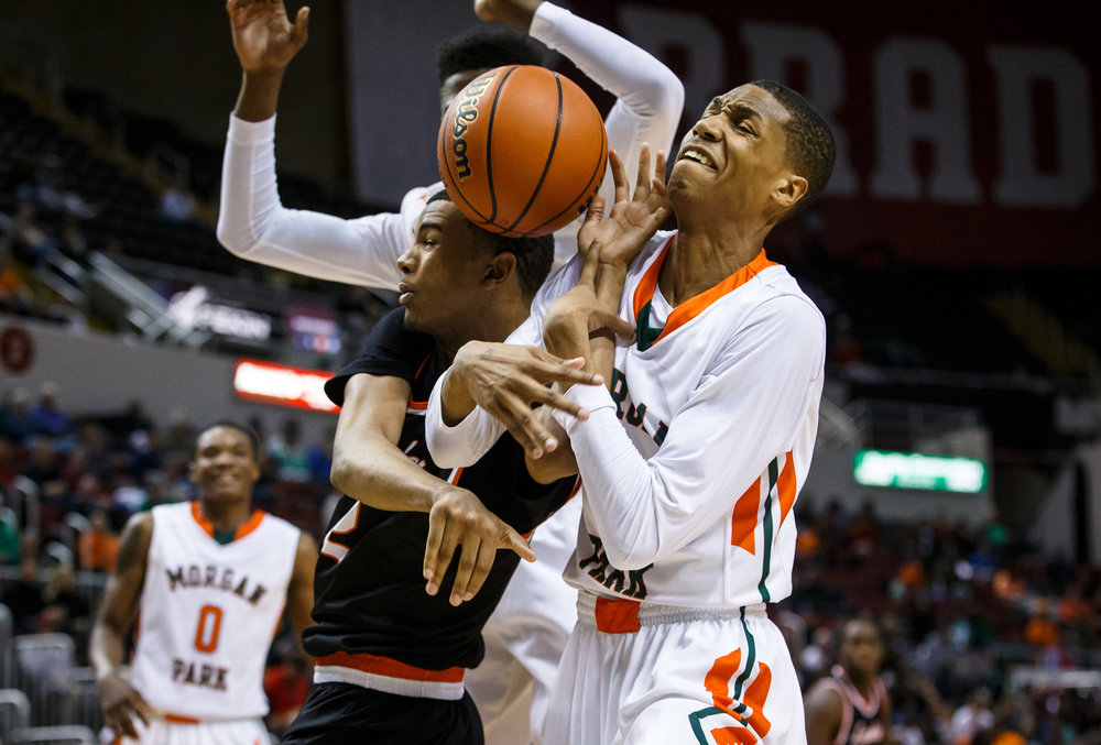 Lanphier's Cardell McGee (2) gets tangled up with Chicago Morgan Park's Cam Burrell (3) going for a rebound in the third quarter during the semifinals of the IHSA Class 3A Basketball State Finals at Carver Arena, Friday, March 17, 2017, in Peoria, Ill. [Justin L. Fowler/The State Journal-Register]