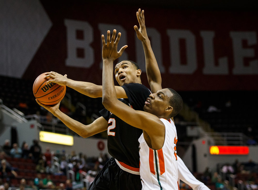 Lanphier's Cardell McGee (2) puts up a shot against Chicago Morgan Park's Lenell Henry (23) in the third quarter during the semifinals of the IHSA Class 3A Basketball State Finals at Carver Arena, Friday, March 17, 2017, in Peoria, Ill. [Justin L. Fowler/The State Journal-Register]