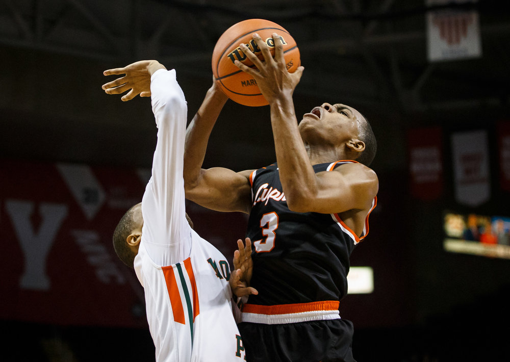 Lanphier's Aundrae Williams (3) draws the foul as he drives up to the basket against Chicago Morgan Park's Cam Burrell (3) in the third quarter during the semifinals of the IHSA Class 3A Basketball State Finals at Carver Arena, Friday, March 17, 2017, in Peoria, Ill. [Justin L. Fowler/The State Journal-Register]