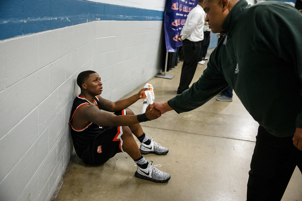 Lanphier's Yaakema Rose (1) gets a hand shake as he waits to be interviewed following the Lions 60-53 lose to Chicago Morgan Park in the semifinals of the IHSA Class 3A Basketball State Finals at Carver Arena, Friday, March 17, 2017, in Peoria, Ill. [Justin L. Fowler/The State Journal-Register]