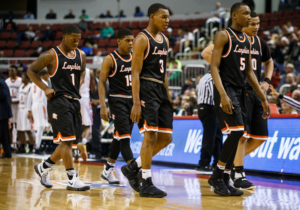 Lanphier's Aundrae Williams (3) and the Lions walk to the bench trailing Chicago Morgan Park in the fourth quarter during the semifinals of the IHSA Class 3A Basketball State Finals at Carver Arena, Friday, March 17, 2017, in Peoria, Ill. [Justin L. Fowler/The State Journal-Register]