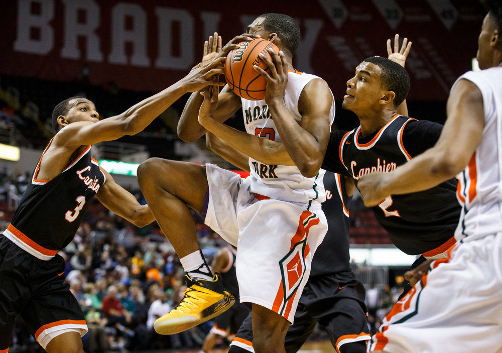 Lanphier's Aundrae Williams (3) and Lanphier's Cardell McGee (2) try to knock a rebound loose from Chicago Morgan Park's Lenell Henry (23) in the fourth quarter during the semifinals of the IHSA Class 3A Basketball State Finals at Carver Arena, Friday, March 17, 2017, in Peoria, Ill. [Justin L. Fowler/The State Journal-Register]