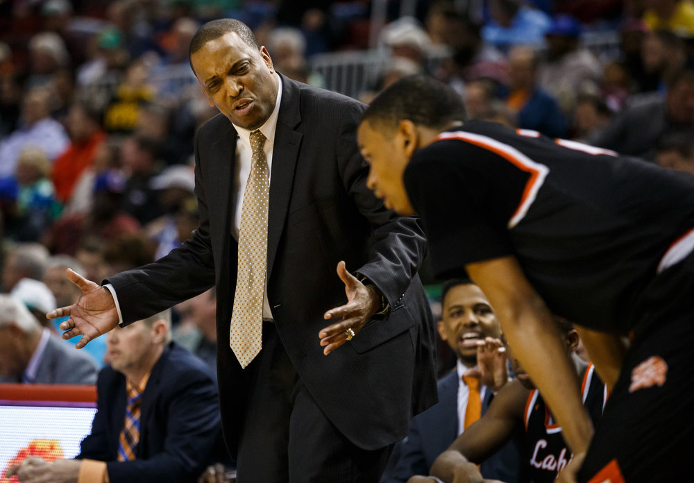 Lanphier boys basketball head coach Blake Turner talks with Lanphier's Cardell McGee (2) late in the fourth quarter as the Lions trail Chicago Morgan Park during the semifinals of the IHSA Class 3A Basketball State Finals at Carver Arena, Friday, March 17, 2017, in Peoria, Ill. [Justin L. Fowler/The State Journal-Register]