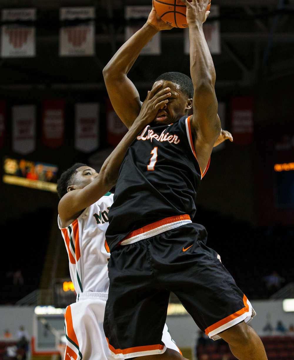 Lanphier's Yaakema Rose (1) takes a shot to the face with no foul call as he pulls in a rebound in the fourth quarter during the semifinals of the IHSA Class 3A Basketball State Finals at Carver Arena, Friday, March 17, 2017, in Peoria, Ill. [Justin L. Fowler/The State Journal-Register]