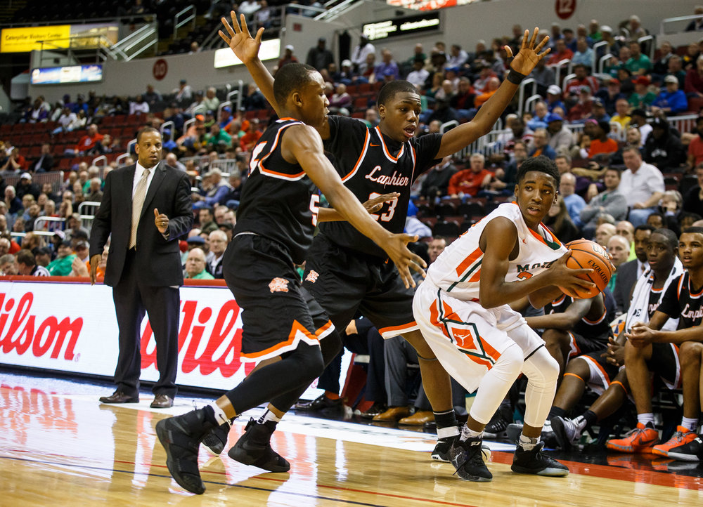 Lanphier's P.J. Edwards (23) and Lanphier's James Jones (5) try to force a turnover from Chicago Morgan Park's Marcus Watson (22) in the fourth quarter during the semifinals of the IHSA Class 3A Basketball State Finals at Carver Arena, Friday, March 17, 2017, in Peoria, Ill. [Justin L. Fowler/The State Journal-Register]
