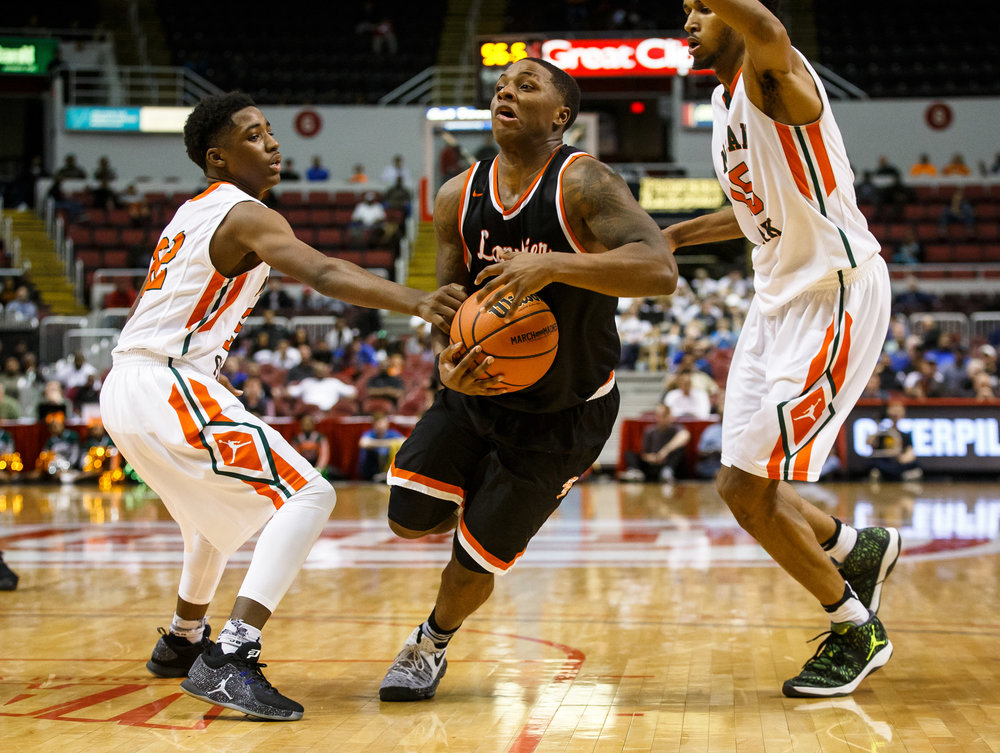 Lanphier's Yaakema Rose (1) drives to the basket against Chicago Morgan Park's Marcus Watson (22) in the fourth quarter during the semifinals of the IHSA Class 3A Basketball State Finals at Carver Arena, Friday, March 17, 2017, in Peoria, Ill. [Justin L. Fowler/The State Journal-Register]