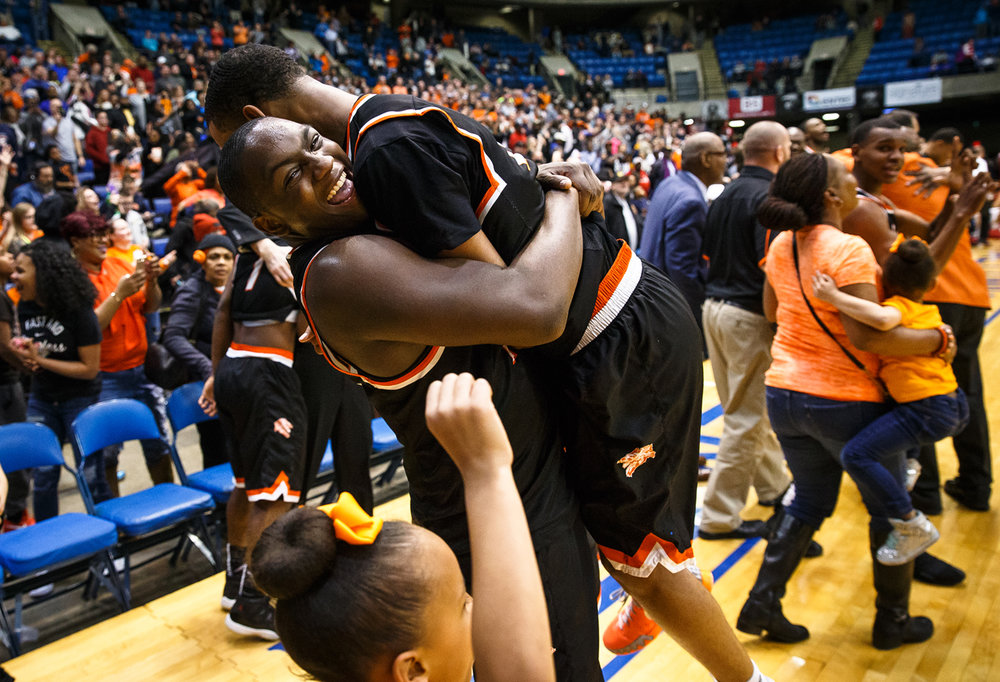 Lanphier's Corrington Jones (10) hoists up Lanphier's Cardell McGee (2) as the Lions celebrate their 64-38 victory over Centralia in the Class 3A Springfield Supersectional at the Prairie Capital Convention Center, Tuesday, March 14, 2017, in Springfield, Ill. [Justin L. Fowler/The State Journal-Register]
