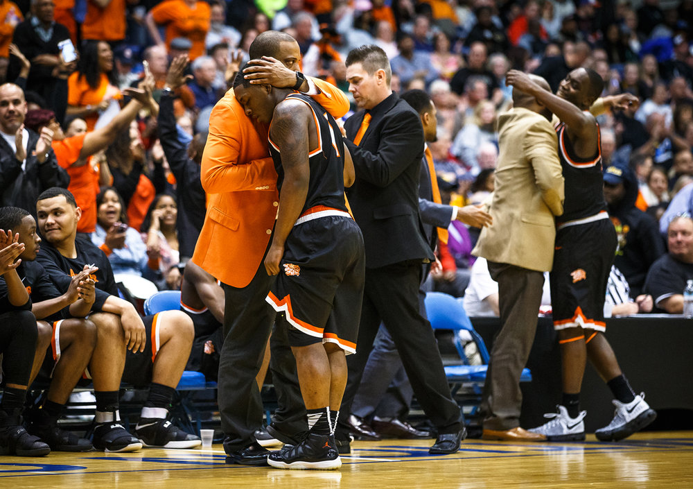 Lanphier boys basketball head coach Blake Turner hugs Lanphier's Yaakema Rose (1) as the starters come out of the game with victory in hand against Centralia in the fourth quarter during the Class 3A Springfield Supersectional at the Prairie Capital Convention Center, Tuesday, March 14, 2017, in Springfield, Ill. [Justin L. Fowler/The State Journal-Register]