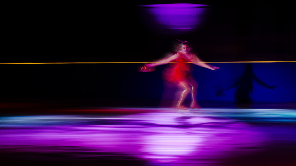 "Bailey Manuel glides across the ice during a long exposure pan at the Spotlight on Ice 2017 ""Broadway Rhythms"" at the Nelson Center Saturday, March 18, 2017.  [Ted Schurter/The State Journal-Register]"