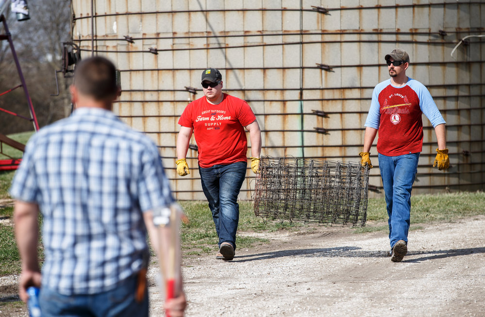 Brett Langley, left, of Jacksonville, Ill., and Colby Livengood, right, of Virginia, Ill., load up rolls of fencing that were gathered by the Cass-Morgan Farm Bureau Young Leaders for a wildfire relief donation drive at Jackson Farms, Friday, March 24, 2017, in Jacksonville, Ill. The hay and supplies donated from around central Illinois is being taken by convoy to aid the Kansas livestock farms devastated by wildfires. [Justin L. Fowler/The State Journal-Register]