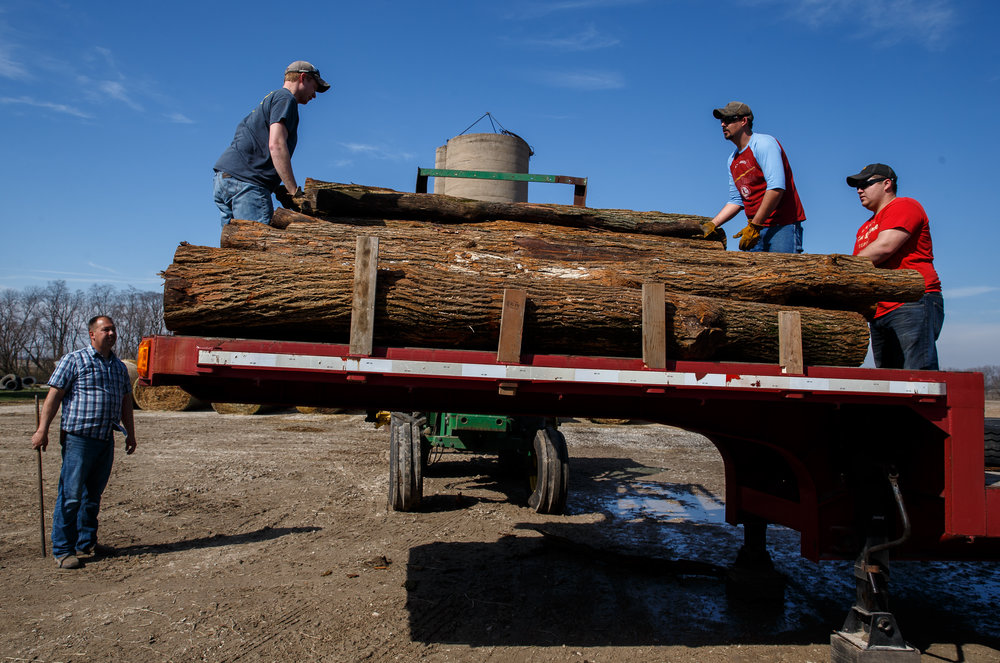 Hedge posts are loaded up on a trailer by volunteers from the Cass-Morgan Farm Bureau Young Leaders for a wildfire relief donation drive at Jackson Farms, Friday, March 24, 2017, in Jacksonville, Ill. The hedge posts along with other supplies and hay are being taken by convoy to aid the Kansas livestock farms devastated by wildfires. [Justin L. Fowler/The State Journal-Register]