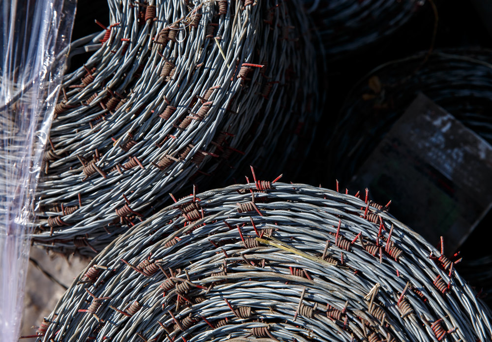 Spirals of barbed-wire ready to be loaded on to a truck as part of the supplies collected by the Cass-Morgan Farm Bureau Young Leaders for a wildfire relief donation drive at Jackson Farms, Friday, March 24, 2017, in Jacksonville, Ill. The supplies and hay are being taken by convoy to aid the Kansas livestock farms devastated by wildfires. [Justin L. Fowler/The State Journal-Register]