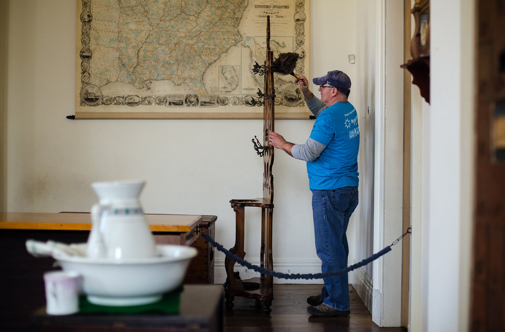 Cort Carlson dusts furniture in the Secretary of State's office at the Old State Capitol Sunday, March 19, 2017. Carleson and other members of the Illinois tourism industry helped pick up trash, spruced up landscaping and cleaned interiors as part of a partnership between Illinois VolunTourism and the Illinois Historical Preservation Agency. [Ted Schurter/The State Journal-Register]