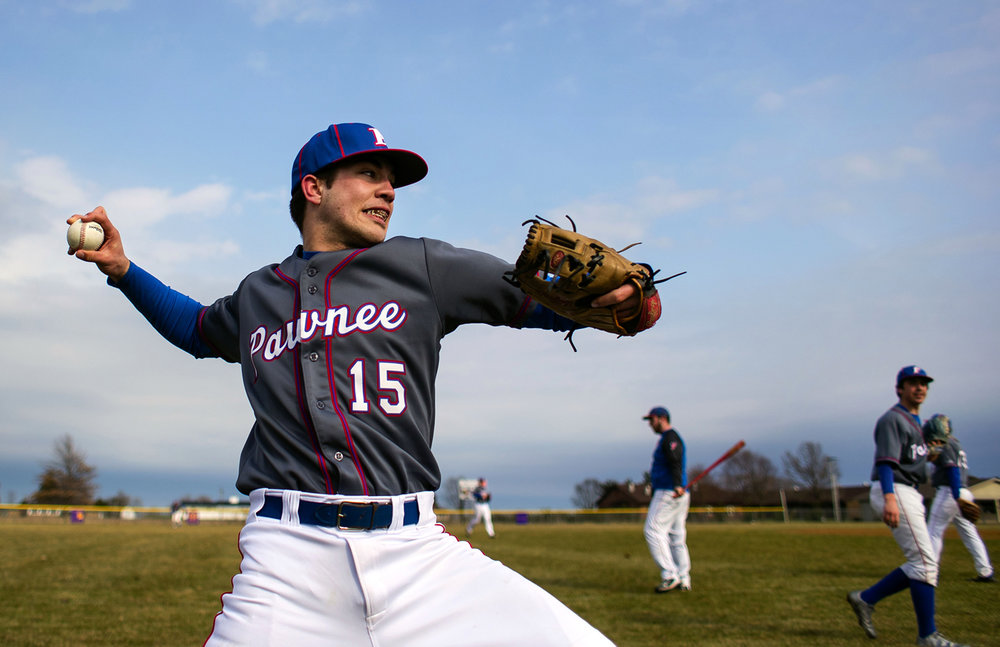 Pawnee pitcher Cade Hennemann warms up before facing Mount Pulaski at Veterans Park Thursday, March 23, 2017. New rules instituted by the Illinois High School Association require a specified amount of rest time for a pitcher depending on how many pitches he throws in a day. [Ted Schurter/The State Journal-Register]