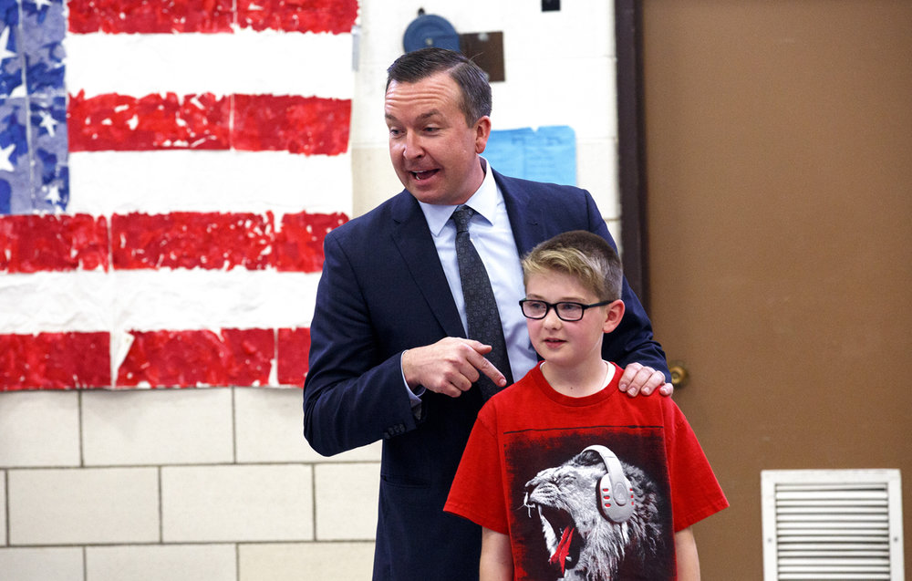 """What if Rylen made all the rules for everybody?"" asks Sen. Andy Manar, pointing to Lincoln School student Rylen Warren in Pana Tuesday, March 21, 2017. Manar was explaining to the school's fifth graders how compromise works in the legislative process during a visit to discuss the soda tax, which had been suggested during budget talks as a source of revenue. The students had written letters to Manar sharing their opinions about the tax. [Rich Saal/The State Journal-Register]"